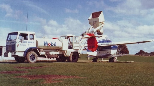 A Typical day topdressing in the 1980's. This picture shows the PL12 Airtruck and John was one of the first operators to switch to this aircraft from the traditional Fletcher which had been the used for Aerial topdressing since the late 1950's.